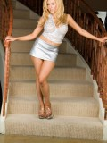 Blonde Slut Vivian West Toys Her Pussy on the Stairs 01